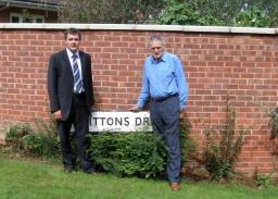 Andrew Simpson and Dennis Meredith by wall in Brittons Drive